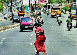 india-bangalore-pedestria woman crossing