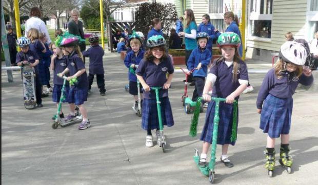 new zeeland - children on scooters helmets - 2