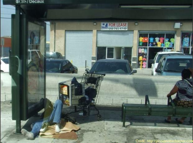 bus stop vagrant sleeping