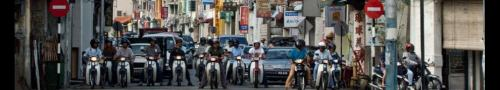 malaysia penang motor cycles at stop light
