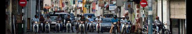 malaysia penang motor cycles at stop light