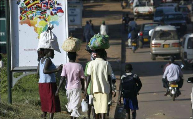 uganda women street carrying on heads