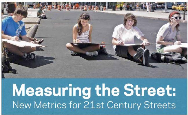 Measuring the street.  Happy City Saint John's