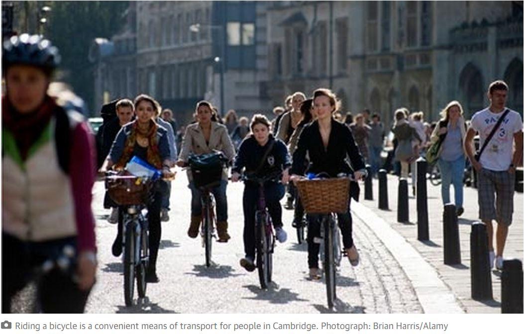 UK cambridge women cycling in streeet